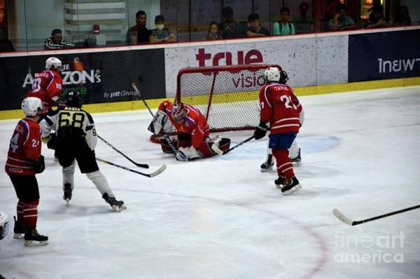 Photograph - Mongolia Team Players Defend Goal Vs Malaysia In Ice Hockey Match In Rink Bangkok Thailand by Imran Ahmed