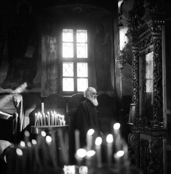 Photograph - Monk And Candles by Emanuel Tanjala