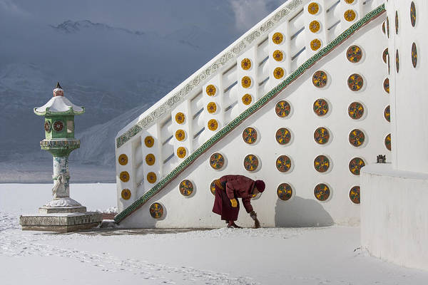 Photograph - Monk Clearing Snow by Hitendra SINKAR