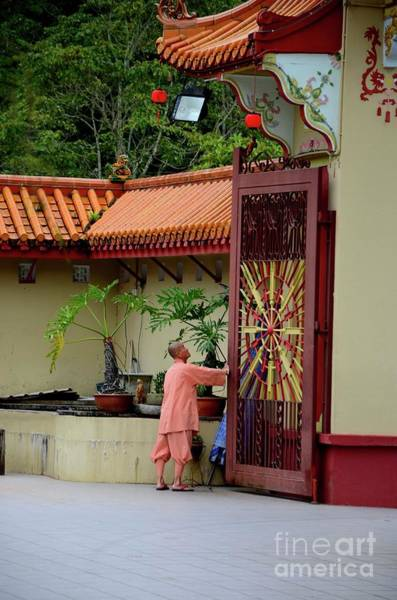 Photograph - Monk Opens Main Gate And Readies Sam Poh Chinese Buddhist Temple Cameron Highlands Malaysia by Imran Ahmed