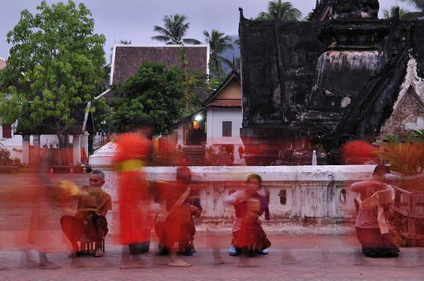 Wall Art - Photograph - Monks At Luang Prabang Laos by Liz Pinchen