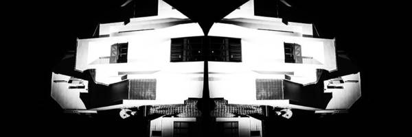 Photograph - Monochrome Building Symmetry Abstract by John Williams