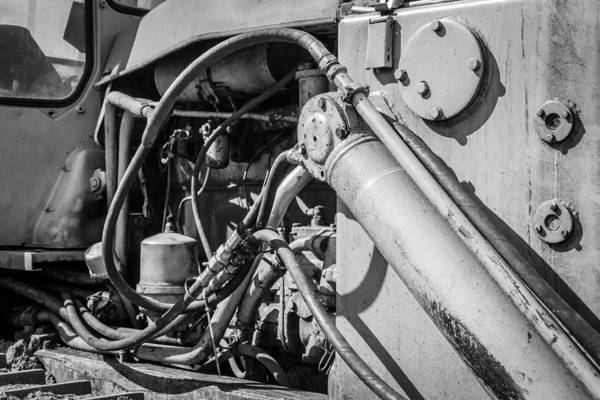 Photograph - Monochrome Of An Industrial Machines Engine Compartment by John Williams