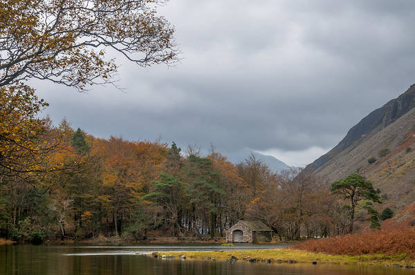 Photograph - Moody Clouds Over A Boathouse On Wast Water In The Lake District by Neil Alexander