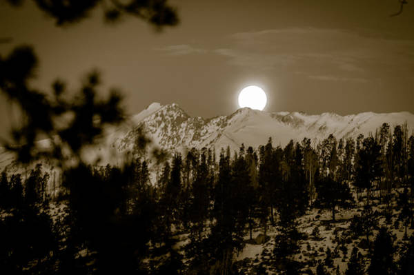 Photograph - moonset over the Rockies by Stephen Holst