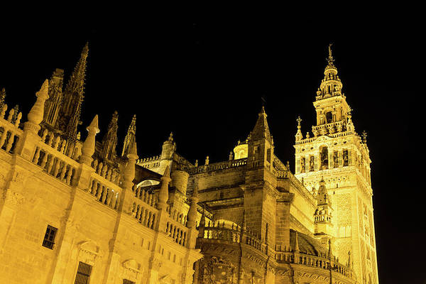 Photograph - Moorish And Gothic Intertwined - La Giralda And Seville Cathedral Illuminated View by Georgia Mizuleva