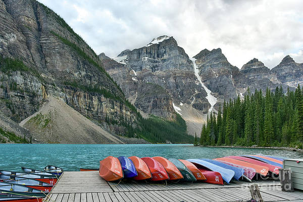 Wall Art - Photograph - Moraine Canoe's Lined Up For The Night by Paul Quinn