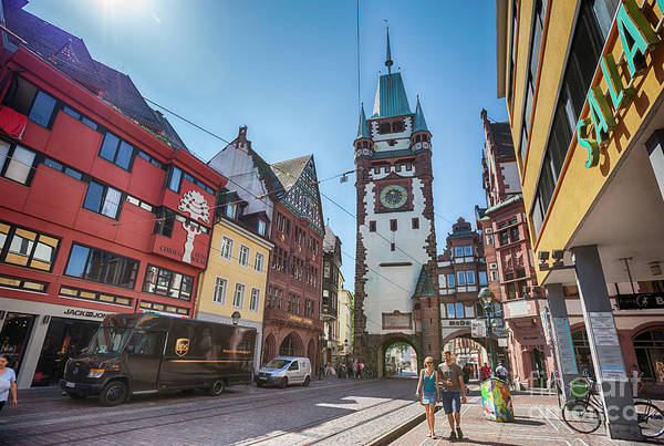 Photograph - morning street with view at The Martinstor, FREIBURG IM BREISGAU by Ariadna De Raadt