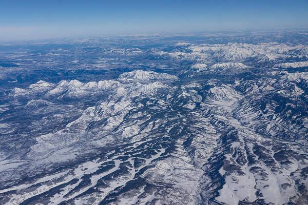 Photograph - Mountains As Far As The Eye Can See - Winter Flight Over The Rockies by Georgia Mizuleva