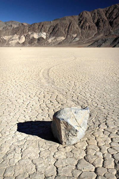 Racetrack Playa Photograph - Moving Rocks Of Death Valley by Pierre Leclerc Photography