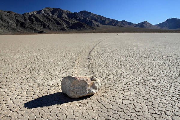 Racetrack Playa Photograph - moving rocks of la playa in Death valley by Pierre Leclerc Photography