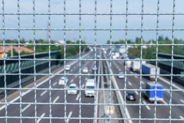 Photograph - Narrow Depth Of Field Looking Down From Railing Onto Busy Highway by Alexandre Rotenberg