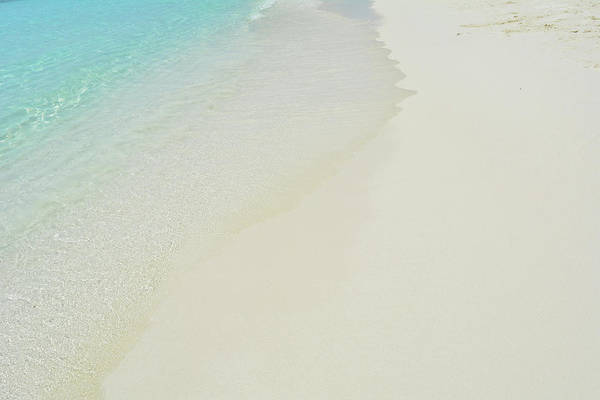 Photograph - Natural Background With Turquoise Water And Light Sand At The Beach by Oana Unciuleanu