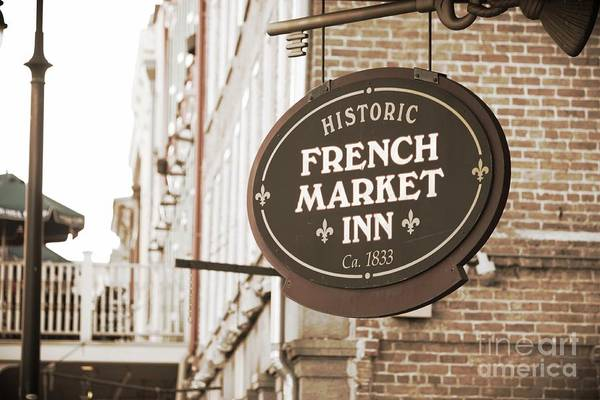 Wall Art - Photograph - New Orleans Hotel Sign In Sepia by Carol Groenen