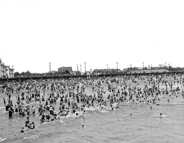 Photograph - New Yorkers At Coney Island. by Underwood Archives