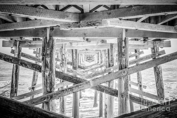 Underneath Photograph - Newport Beach Pier Black And White Photo by Paul Velgos