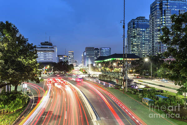 Photograph - Night Traffic In Downtown Jakarta, Indonesia Capital City.  by Didier Marti