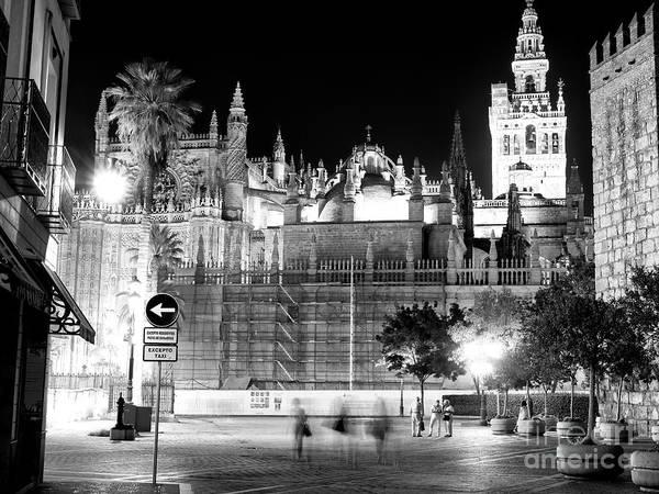 Catedral De Sevilla Wall Art - Photograph - Night Walk In Seville by John Rizzuto