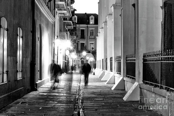 Photograph - Night Walkers In Pirates Alley New Orleans by John Rizzuto