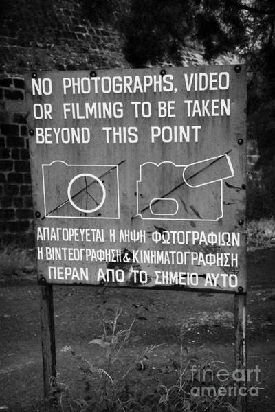 Wall Art - Photograph - no photography warning sign for restricted area of the UN buffer zone in the green line nicosia by Joe Fox