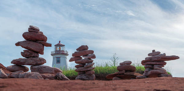 Photograph - North Cape Lighthouse Behind Stone Cairns by Chris Bordeleau
