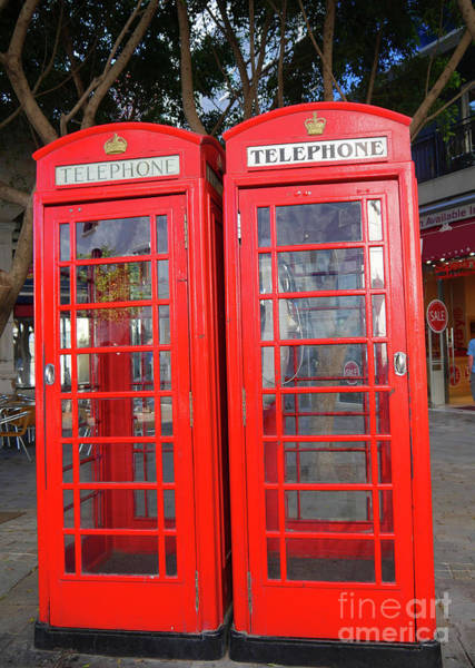 Photograph - Not Quite Identical Twin Phone Boxes In Gibraltar by Brenda Kean
