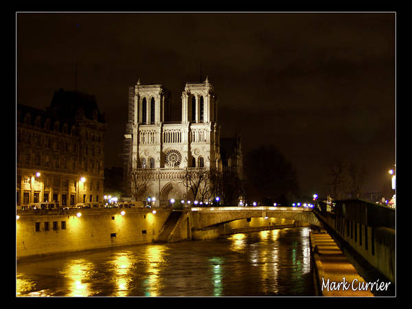 Photograph - Notre Dame On The Seine by Mark Currier