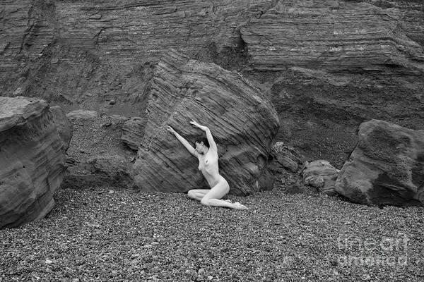 Photograph - Nude Woman Pulling Shape By Rocks by Clayton Bastiani