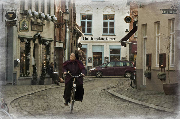 Photograph - Nun On A Bicycle In Bruges by Joan Carroll