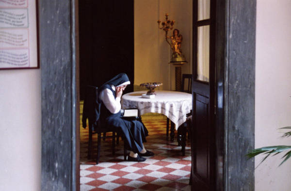 Wall Art - Photograph - Nun Reading The Office by John J O'Hara