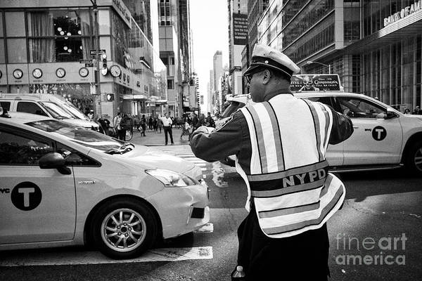 Wall Art - Photograph - nypd traffic officer with whistle in mouth directing traffic on 6th ave New York City USA by Joe Fox