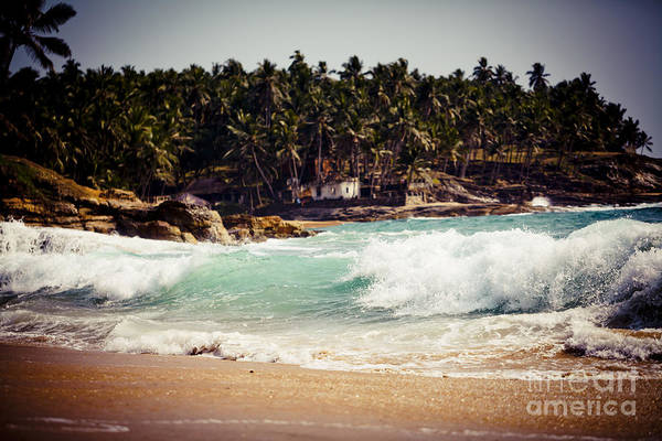 Photograph - Ocean Wave With Rocky Cliffs And Palm Trees by Raimond Klavins