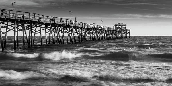 Art Print featuring the photograph Oceana Ocean Crest Fishing Pier In Nc Panorama In Bw by Ranjay Mitra
