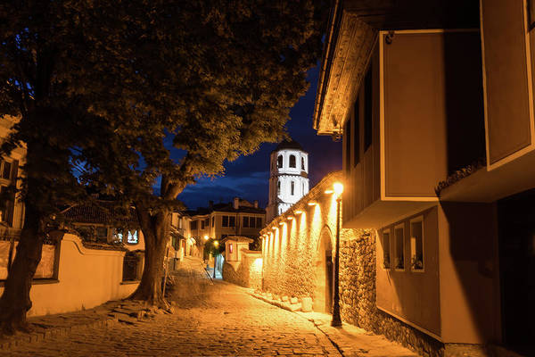 Photograph - Of Cobblestone Streets And Bell Towers - Yellow Lit Night In Old Town Plovdiv Bulgaria by Georgia Mizuleva