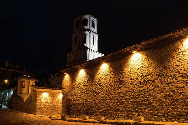 Photograph - Of Stone Walls And Bell Towers - Yellow Lit Night In Old Town Plovdiv Bulgaria by Georgia Mizuleva