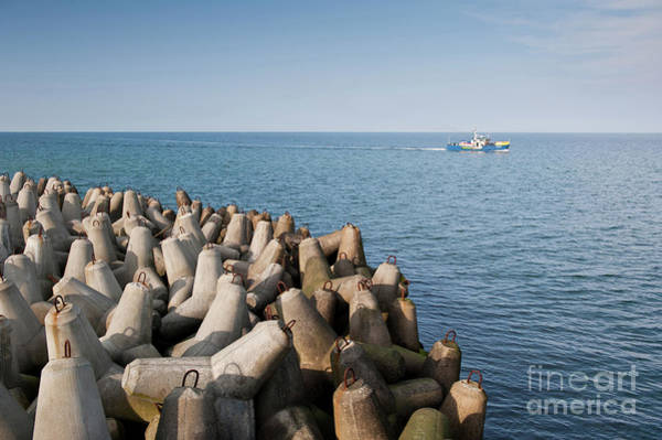 Wall Art - Photograph - Offshore Breakwater Tetrapods And Vessel by Arletta Cwalina
