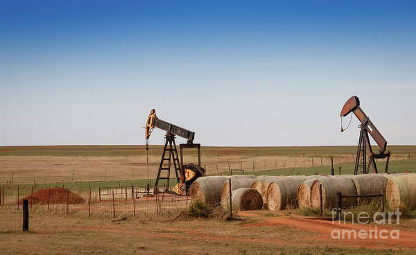Photograph - Oil Pumps And Hay Bales by Richard Smith