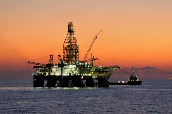 Photograph - Oil Rig And Supply Boat After Sundown by Bradford Martin