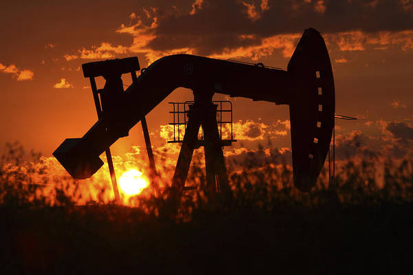 Wall Art - Photograph - Oil Rig Pump Jack Silhouetted By Setting Sun by Mark Duffy
