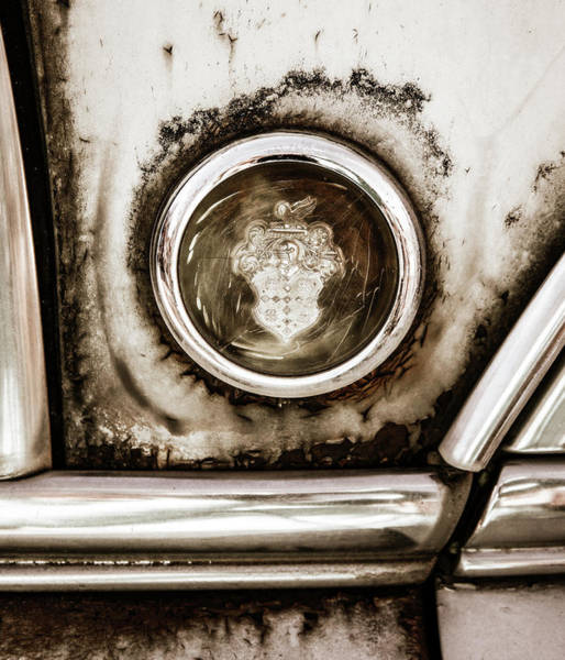 Wall Art - Photograph - Old And Worn Packard Emblem by Marilyn Hunt