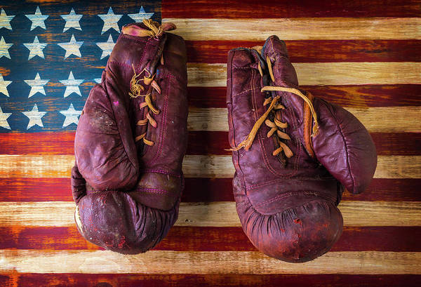 Wall Art - Photograph - Old Boxing Gloves On American Flag by Garry Gay