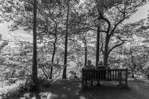 Wall Art - Photograph - Old Couple On The Bench By The Lake by Iordanis Pallikaras