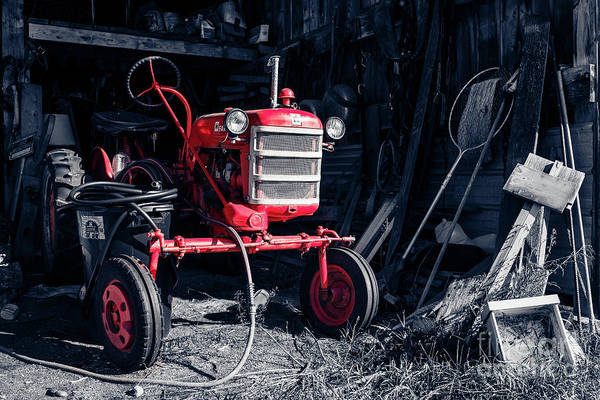 Photograph - Old Farmall Vintage Tractor In The Barn by Edward Fielding