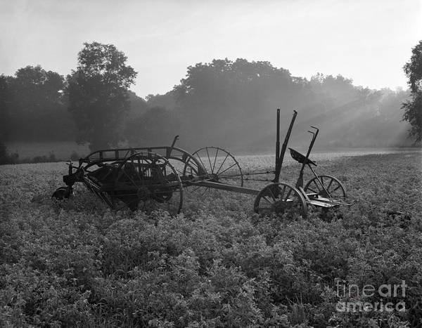 Photograph - Old Hay Baler In Misty Field by H Armstrong Roberts and ClassicStock