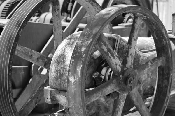 Photograph - Old Industrial Wheel In Black And White by Colleen Cornelius
