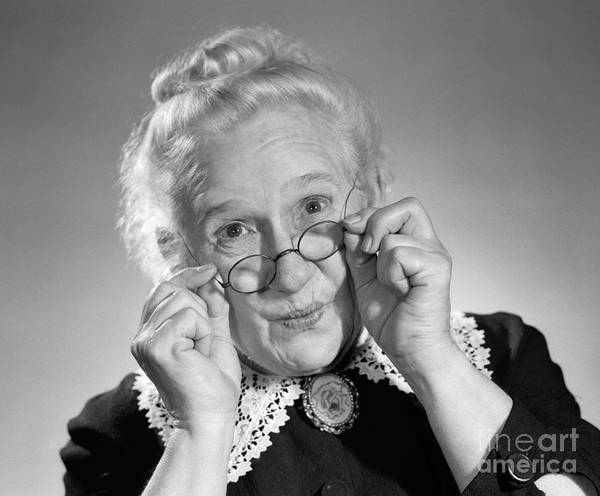 Elder Care Photograph - Old Lady Holding Her Glasses, C.1950s by Debrocke/ClassicStock