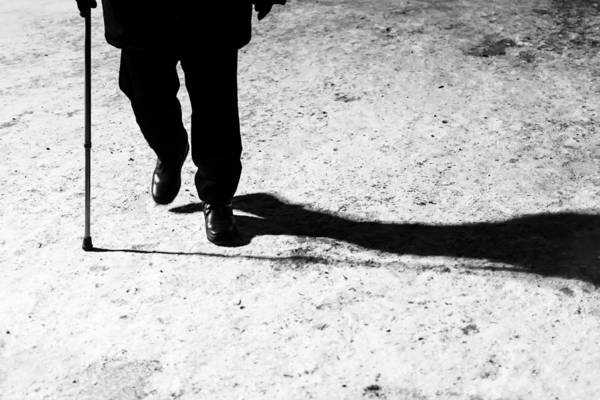 Photograph - Old Man His Walking Stick And His Night Shadow by John Williams