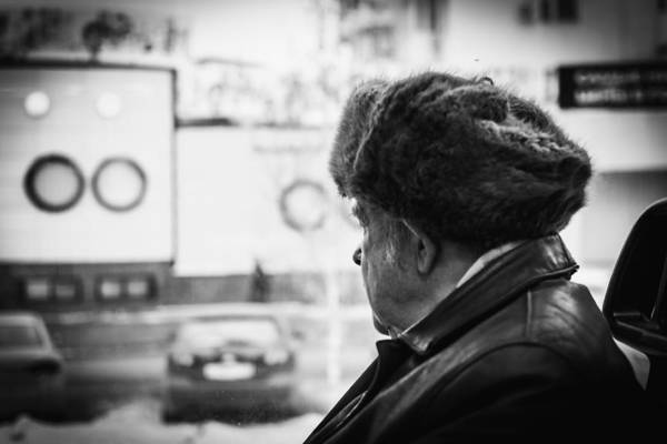 Photograph - Old Man Wearing A Russian Ushanka Riding A Bus by John Williams