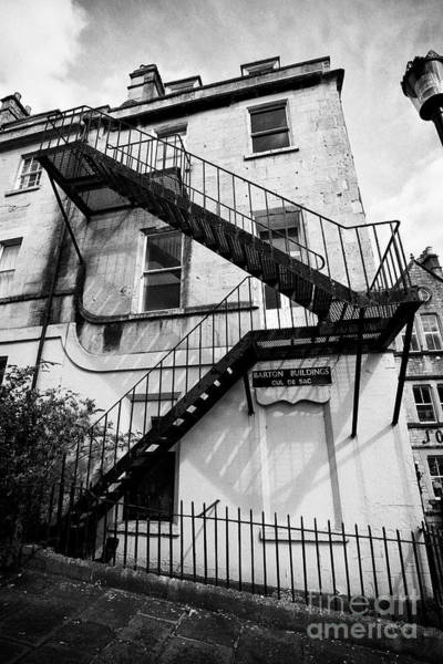 Wall Art - Photograph - Old Metal Fire Escape On Limestone Georgian Townhouse Converted Into Apartments And Commercial Build by Joe Fox