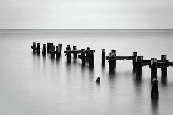 Photograph - Old Pilings Black And White by John Vose